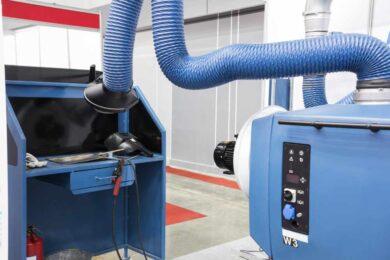industrial welding equipment workshop with welding fume and dust extractor