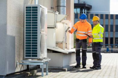 engineers inspecting and air conditioning system